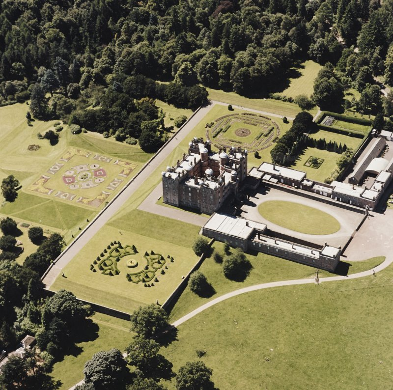 Oblique aerial view centred on the country house, garden, coach house and stables, taken  from the ENE.