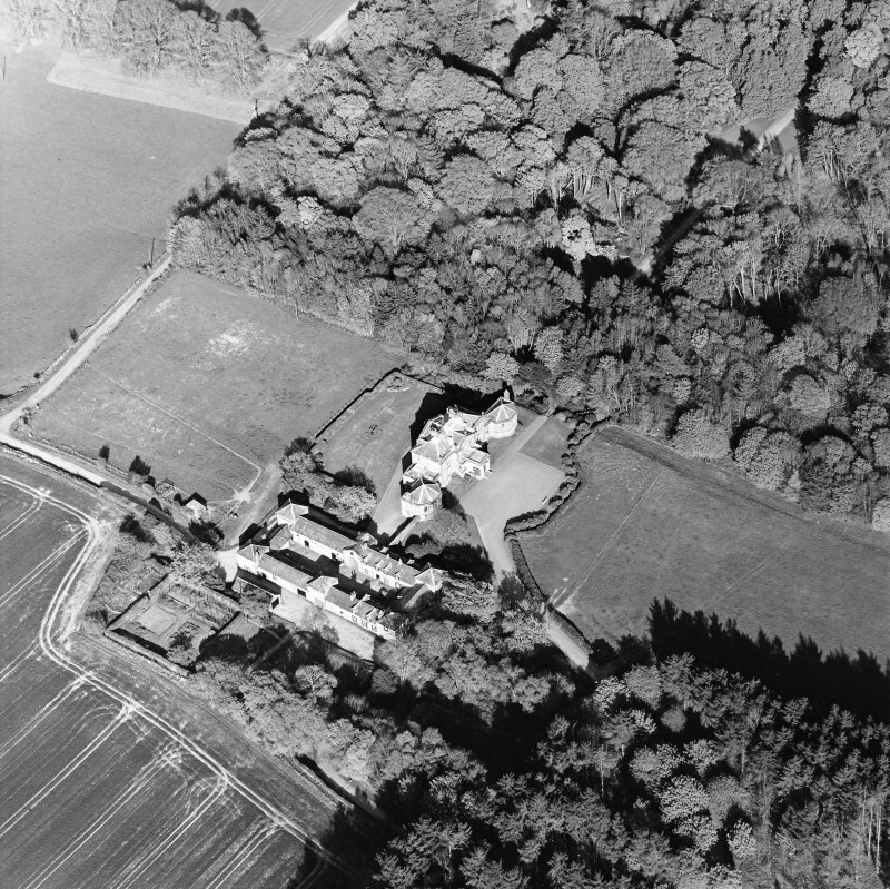 Oblique aerial view centred on the country house and stables, taken from the W.