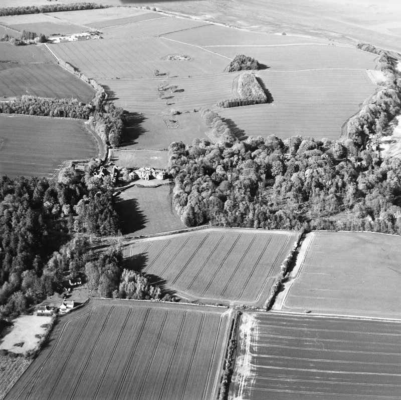 General oblique aerial view looking over cottage, country house, stables and gardens towards Tallowquhairn, taken from the SSW.