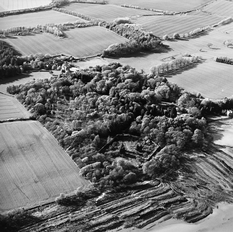 Oblique aerial view centred on the country house, stables, gardens and walled garden, taken from the SSE.