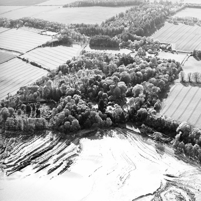 Oblique aerial view centred on the gardens and walled garden with country house, stables and house adjacent, taken from the E.