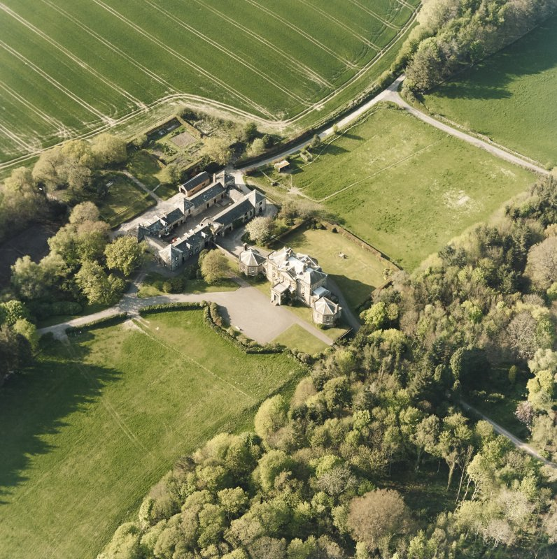 Oblique aerial view centred on the country house and stables, taken from the SSE.