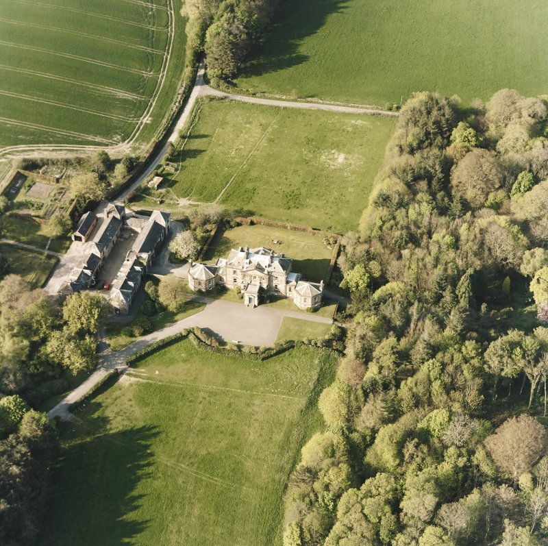 Oblique aerial view centred on the country house and stables, taken from the SSW.