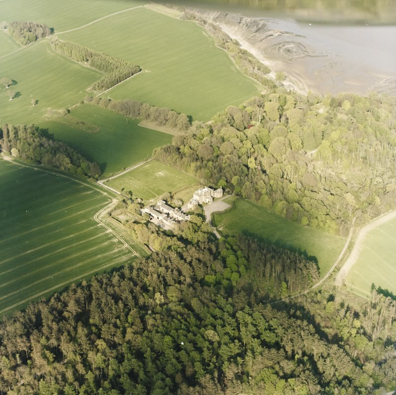 Oblique aerial view centred on the country house and stables with gardens, adjacent, taken from the WSW.