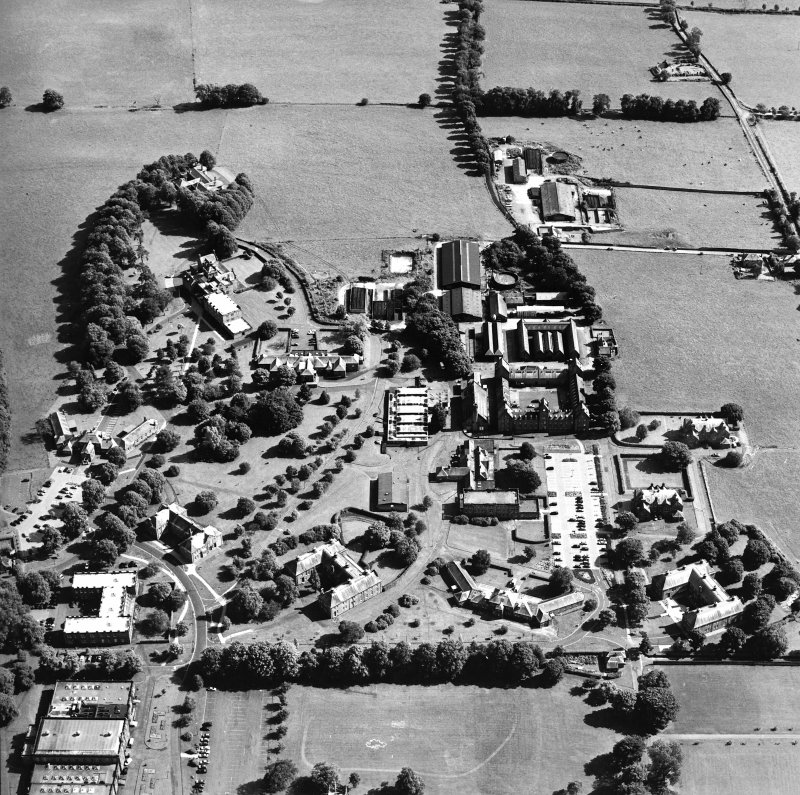 Oblique aerial view centred on the hospital, taken from the NW.