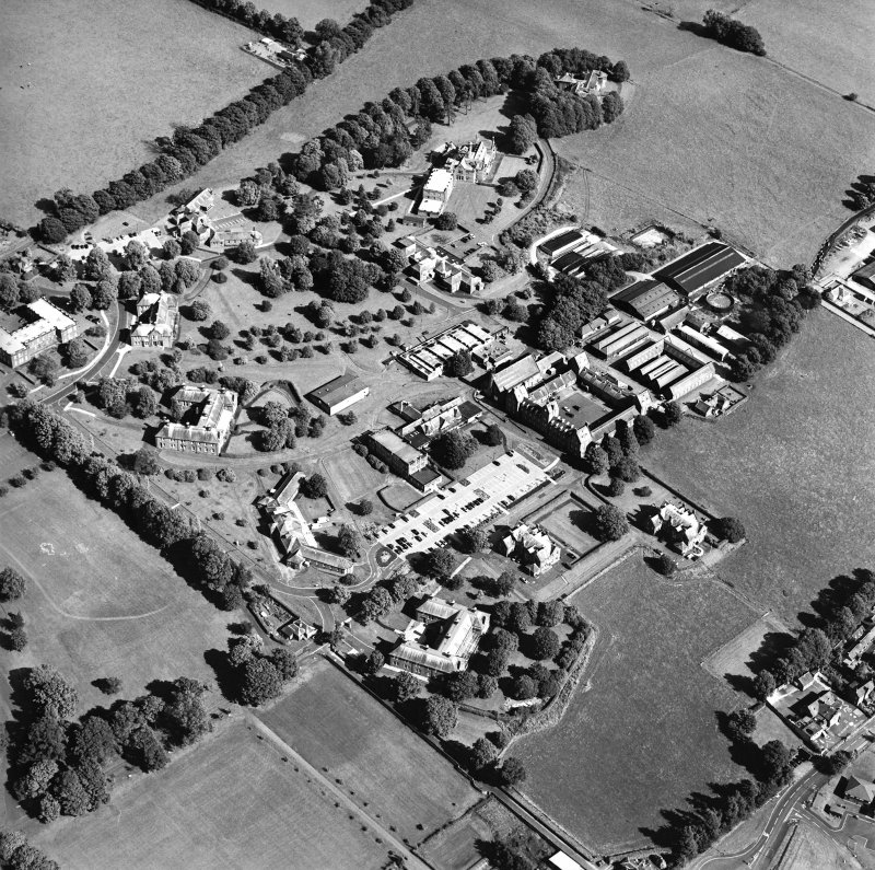 Oblique aerial view centred on the hospital, taken from the WNW.