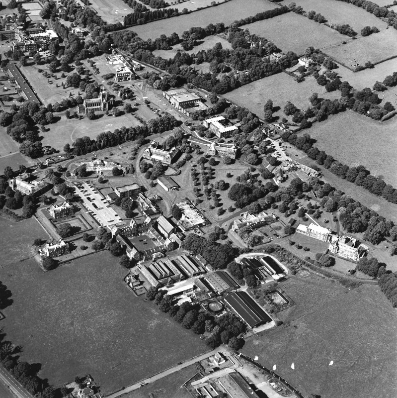 Oblique aerial view centred on the hospital and the church, taken from the S.
