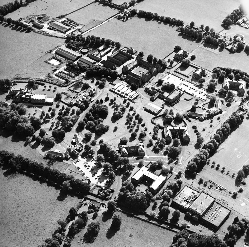 Oblique aerial view centred on the hospital, taken from the NNE.
