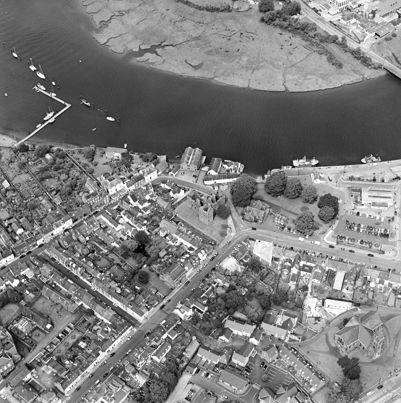 Oblique aerial view of Kirkcudbright centred on MacLellan's Tower, taken from the SSE.