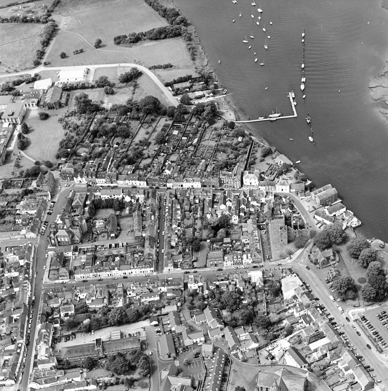 Oblique aerial view of Kirkcudbright centred on MacLellan's Tower, taken from the SE.