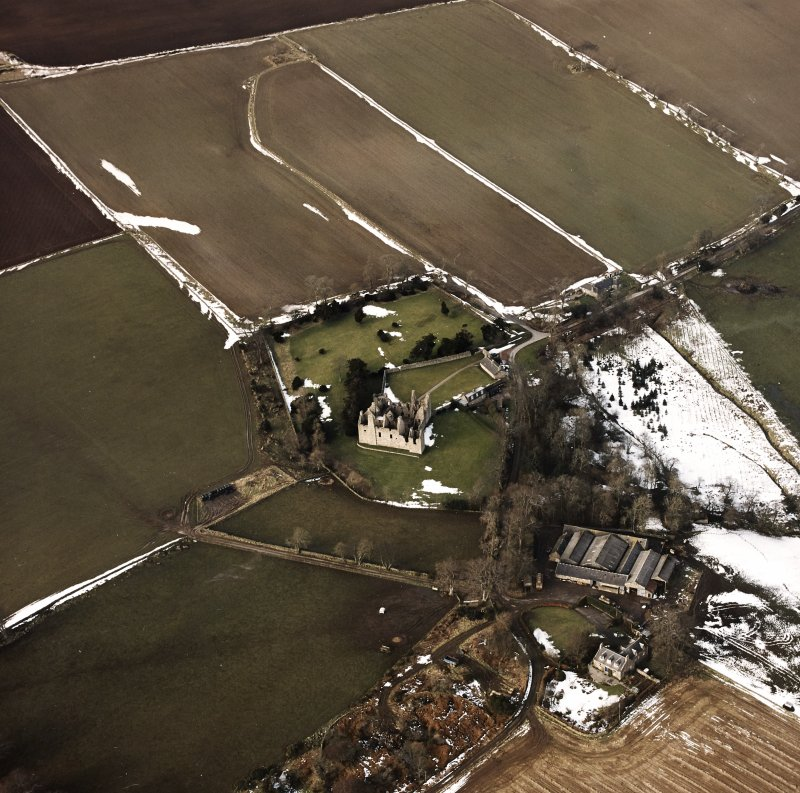 Oblique aerial view centred on the remains of the castle taken from the SE.