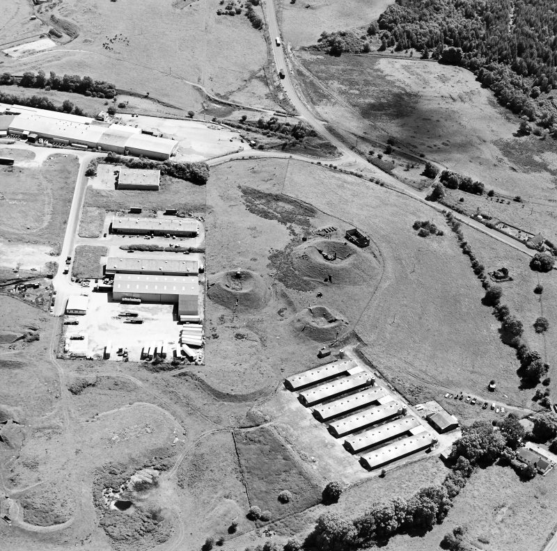 Oblique aerial view centred on Unit 2 of the explosves works and armament depot, showing the earthworks for burette houses and charge houses taken from the NW. Also visible is Edingham Castle,  Edingham Industrial estate with Edingham farm poultry houses.