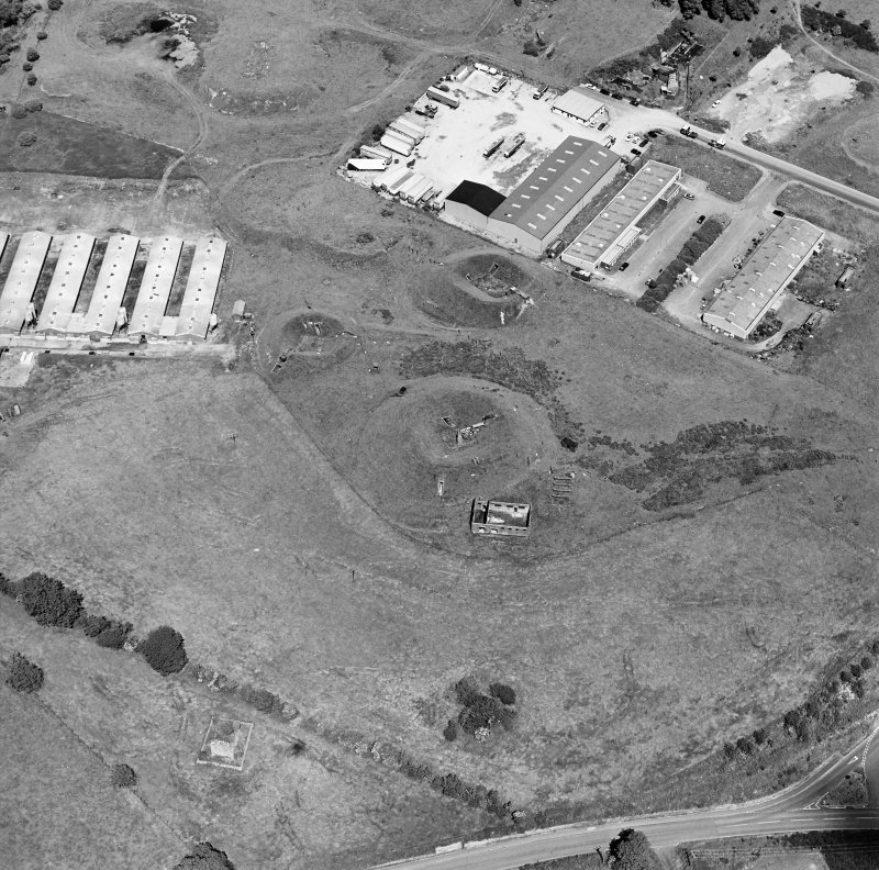 Oblique aerial view centred on Unit 2 of the explosives works and armament depot, showing the earthworks for the charge houses taken from the S. Also visible is Edingham Castle, Edingham Industrial Estate with Edingham farm poultry houses.