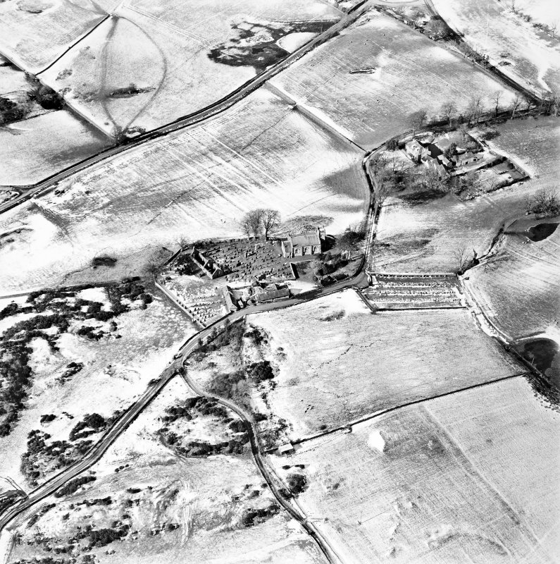 Oblique aerial view centred on the churches, burial-ground and buildings, taken from the ESE.