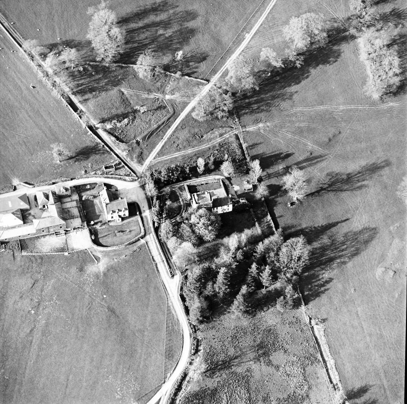 Oblique aerial view centred on the tower-house with farmsteading adjacent, taken from the SW.