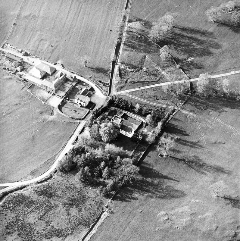 Oblique aerial view centred on the tower-house with farmsteading adjacent, taken from the SSE.