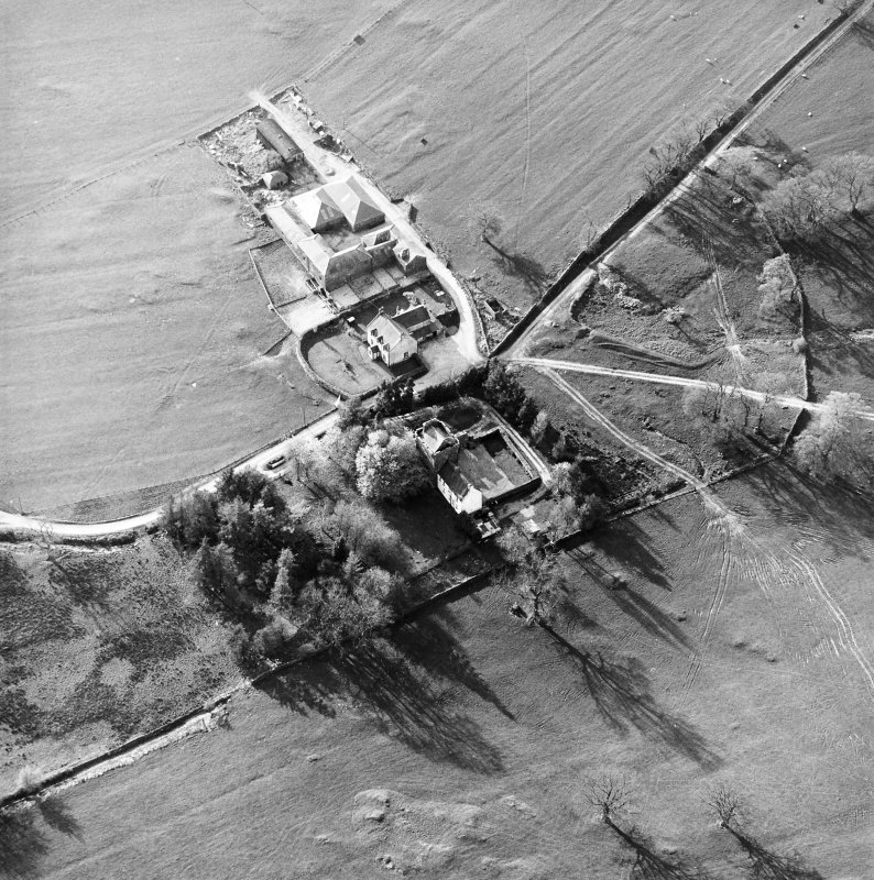 Oblique aerial view centred on the tower-house with farmsteading adjacent, taken from the ESE.