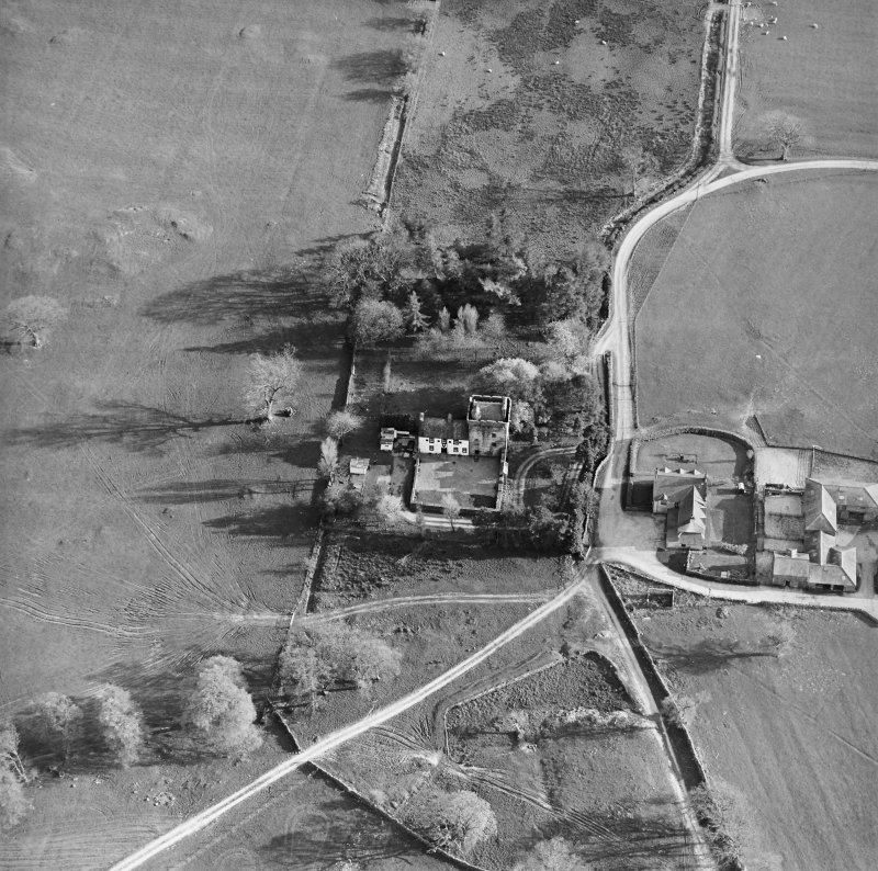 Oblique aerial view centred on the tower-house with farmsteading adjacent, taken from the NNE.