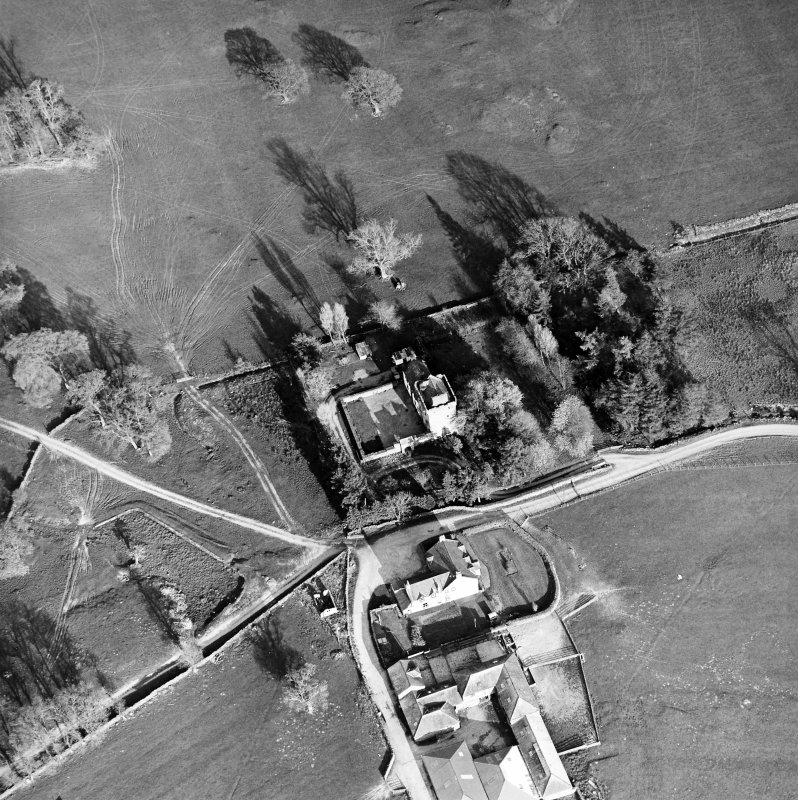 Oblique aerial view centred on the tower-house with farmsteading adjacent, taken from the NW.