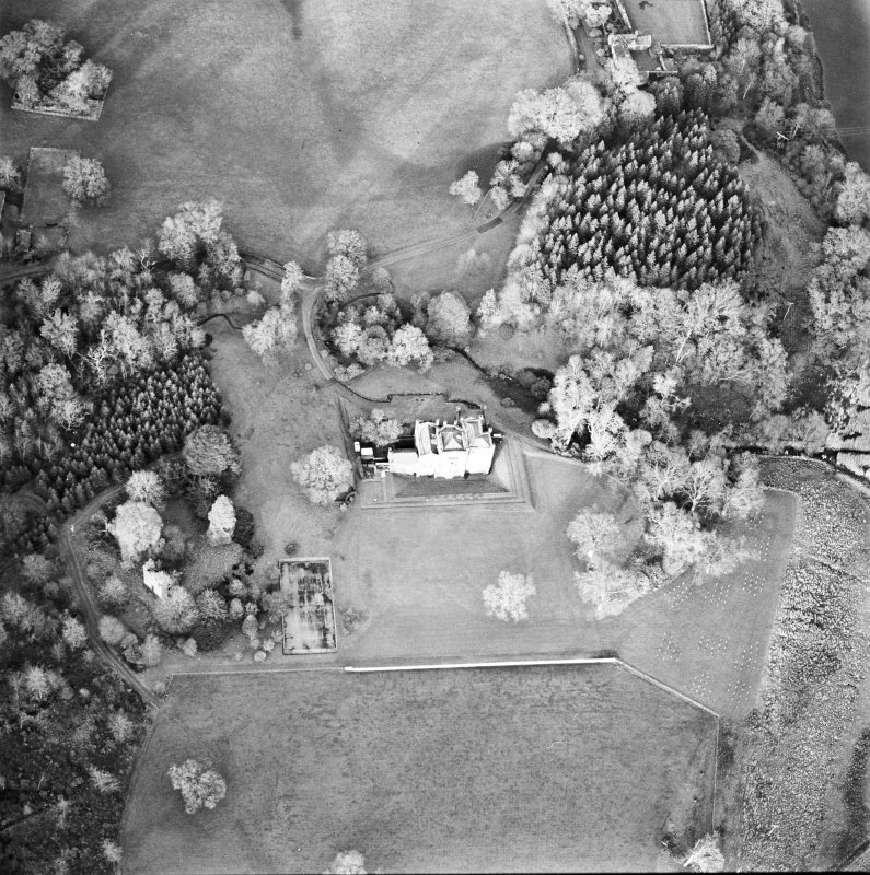 Oblique aerial view centred on the country house with tower-house and garden adjacent, taken from the S.