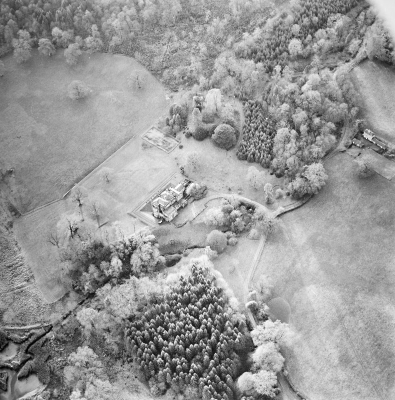 Oblique aerial view centred on the country house with tower-house and garden adjacent, taken from the NE.