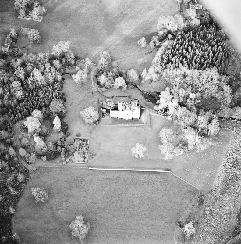 Oblique aerial view centred on the country house with tower-house and garden adjacent, taken from the SSE.