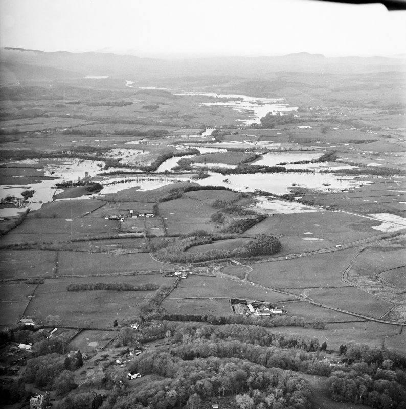 General oblique aerial view looking across Kelton Mains and Threave Castle along the River Dee during flood, taken from the ESE