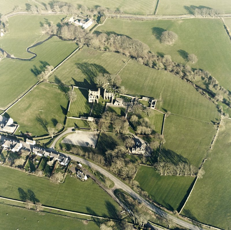 Oblique aerial view centred on the abbey and manse, taken from the W.