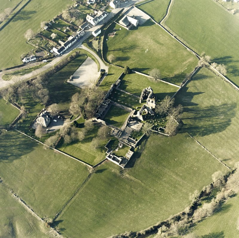 Oblique aerial view centred on the abbey and manse, taken from the SSE.