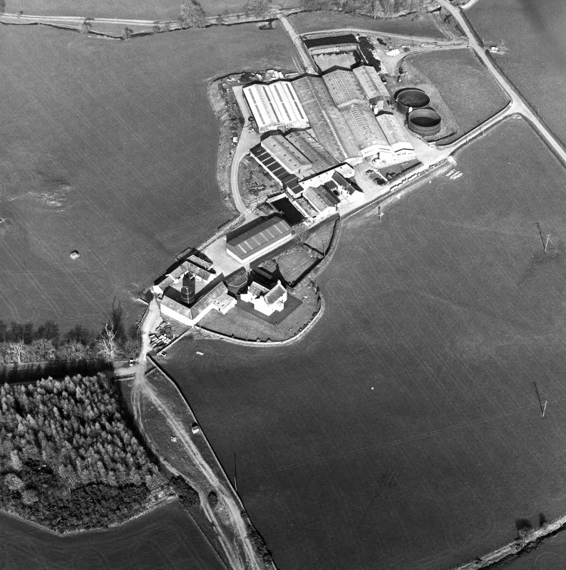 Oblique aerial view centred on the farmstead with the site of the well adjacent, taken from the WSW