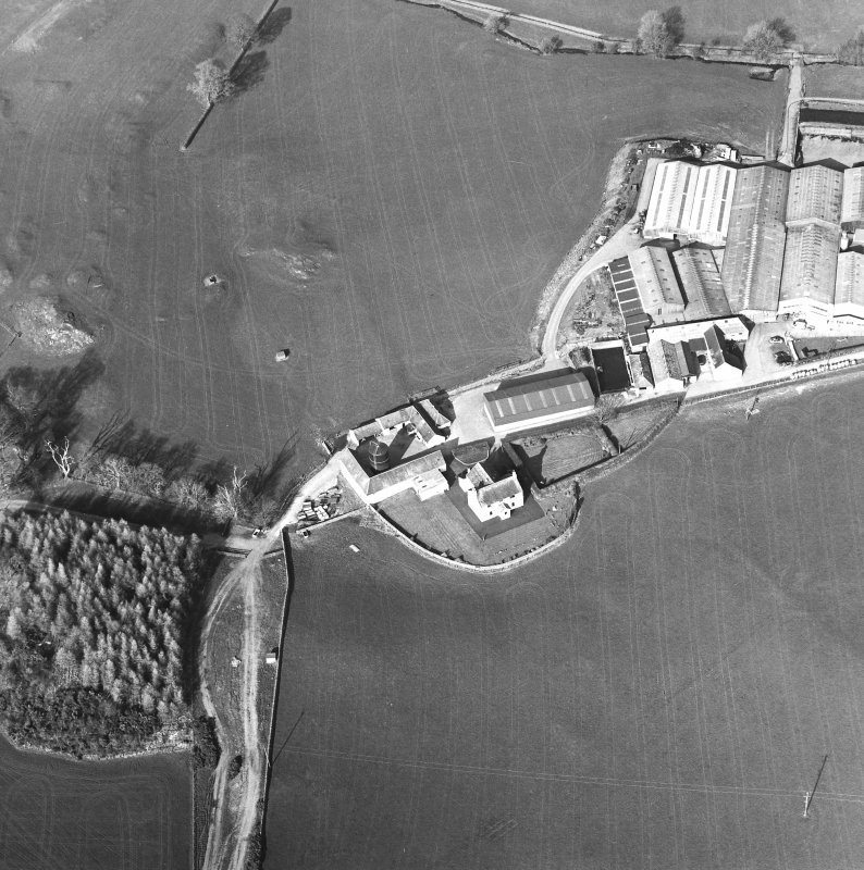 Oblique aerial view centred on the farmstead with the site of the well adjacent, taken from the SW
