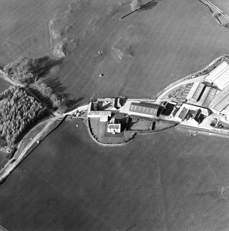 Oblique aerial view centred on the farmstead with the site of the well adjacent, taken from the SSW