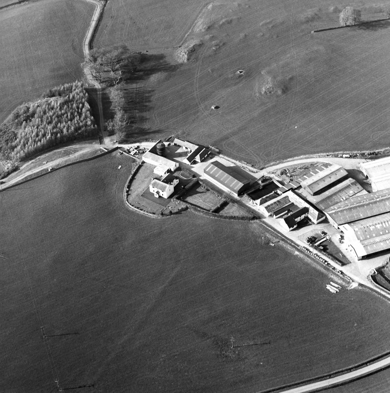 Oblique aerial view centred on the farmstead with the site of the well adjacent, taken from the SSE