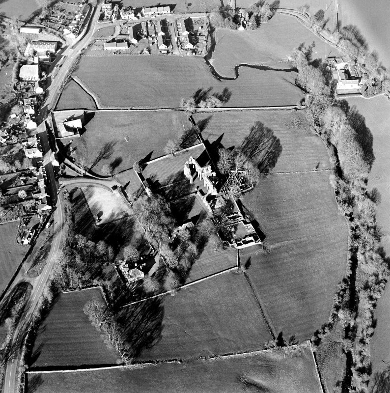 Oblique aerial view centred on the abbey and manse, taken from the WSW.