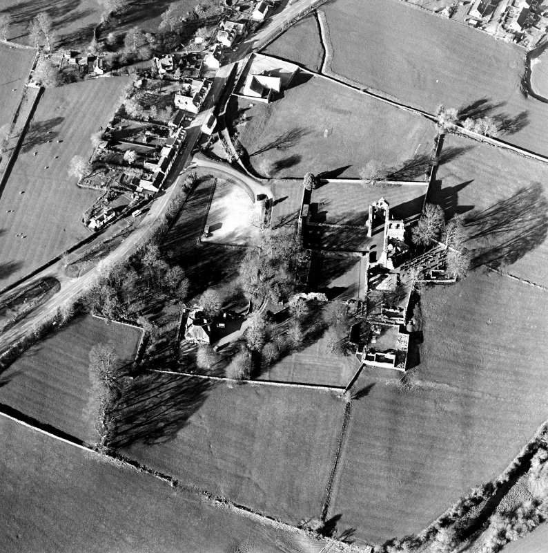 Oblique aerial view centred on the abbey and manse, taken from the S.