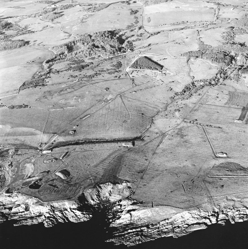Oblique aerial view of Gypsy Point centred on the remains of field banks and rig, with firing point and the site of Balmae House adjacent, taken from the SSE.