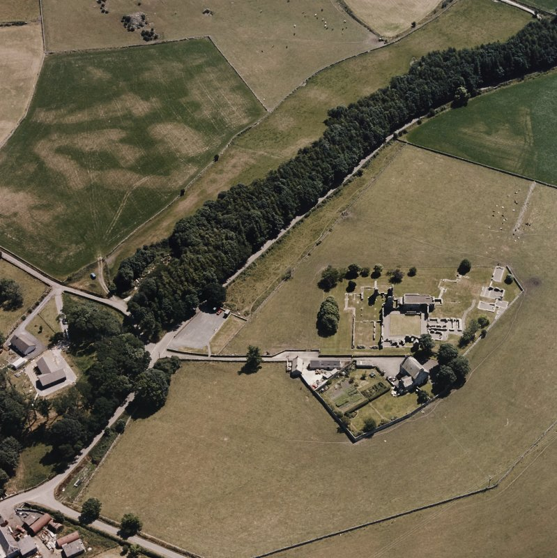 Oblique aerial view centred on Glenluce Abbey.