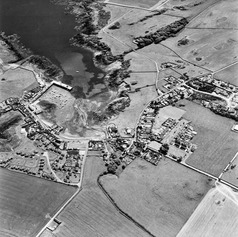 Oblique aerial view, taken from the NE, centred on the village.