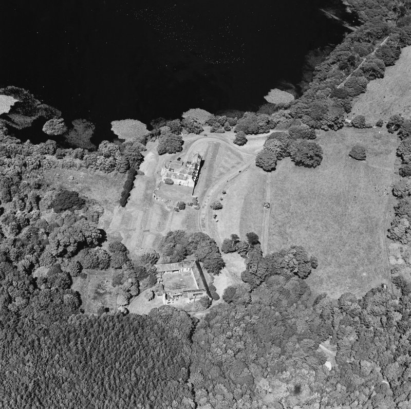Oblique aerial view from SSW, centred on the tower-house.