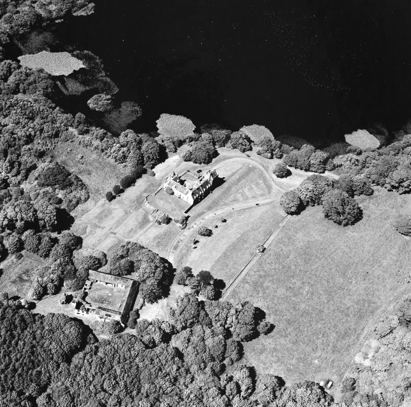 Oblique aerial view from SSE, centred on the tower-house.