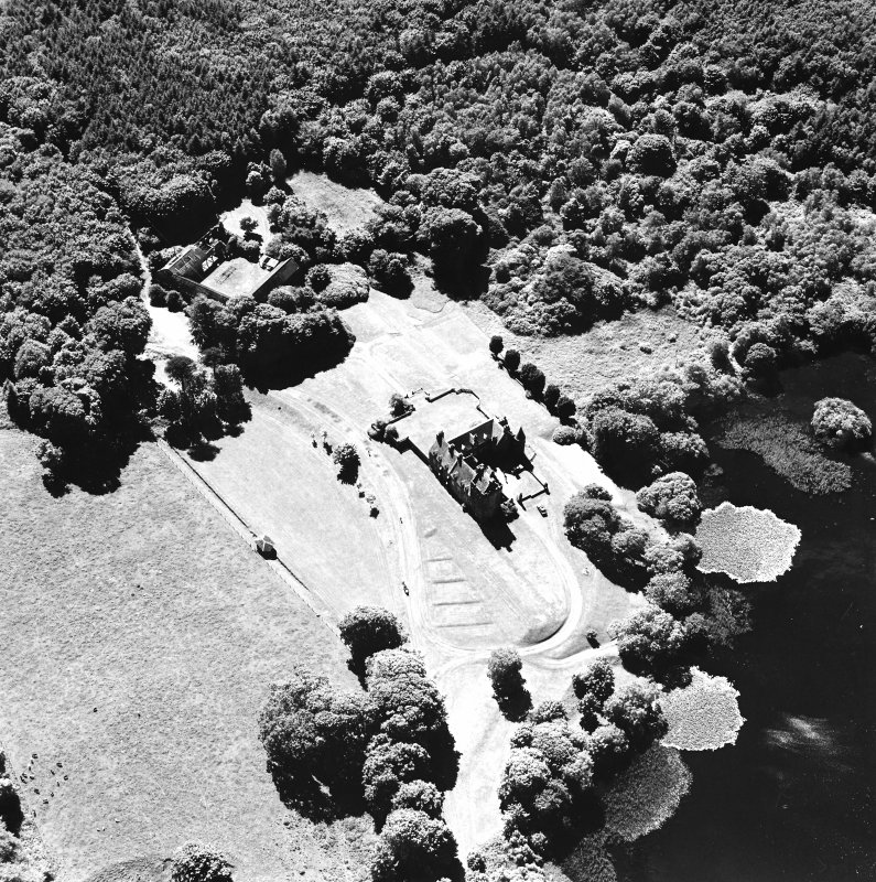 Oblique aerial view from ENE, centred on the tower-house.