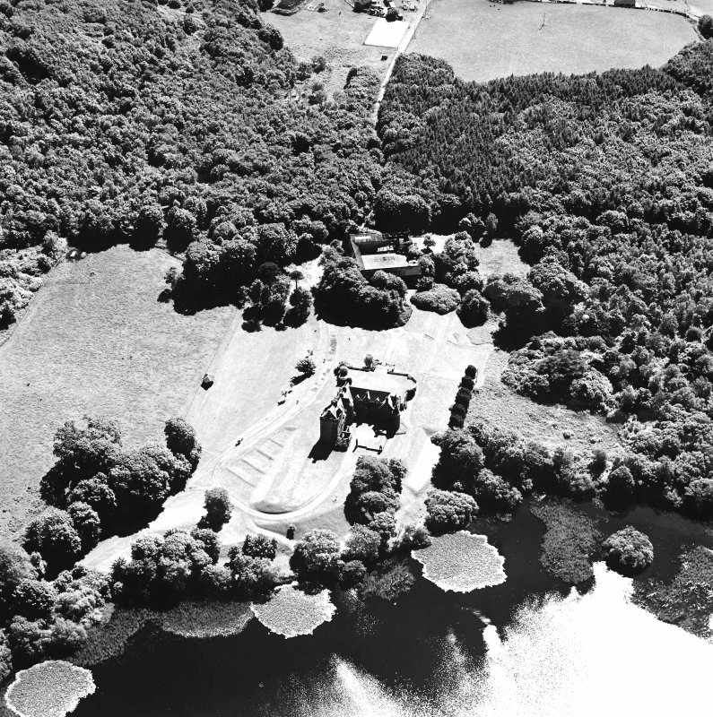 Oblique aerial view from NNE, centred on the tower-house.