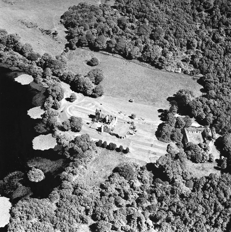 Oblique aerial photograph of Lochnaw Castle taken from the WNW, centred on the tower-house.