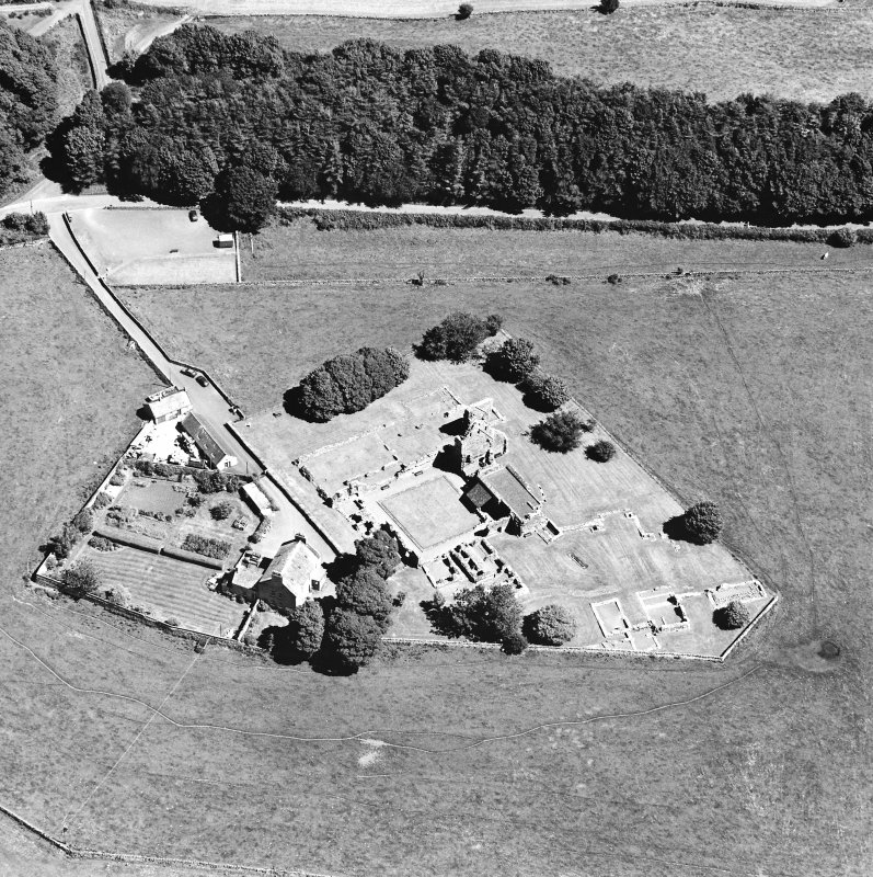 Oblique aerial view centred on the remains of the abbey and abbot¿s house, taken from the WSW.