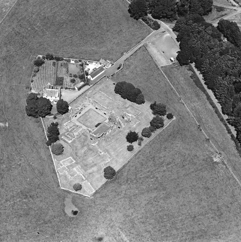 Oblique aerial view centred on the remains of the abbey and abbot¿s house, taken from the SSE.