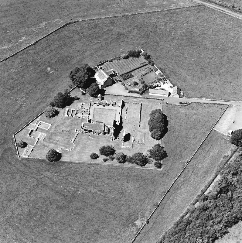 Oblique aerial view centred on the remains of the abbey and abbot¿s house, taken from the ESE.