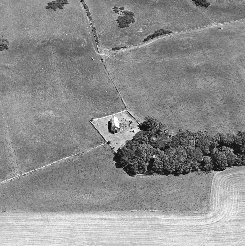 Oblique aerial view centred on the church and burial-ground, taken from the W.