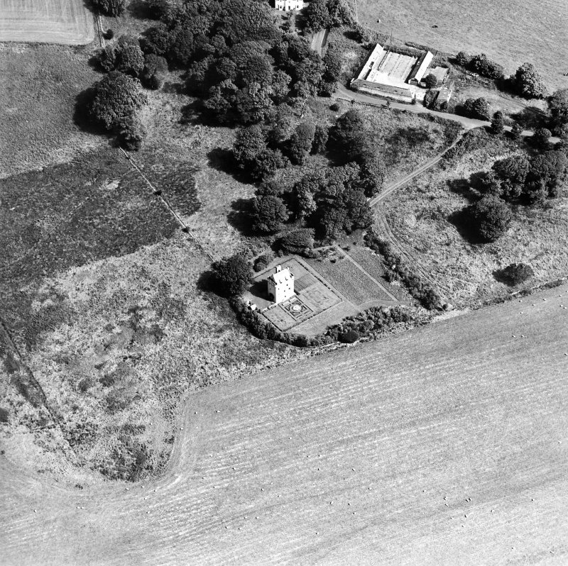 Oblique aerial view centred on the tower-house, taken from the WSW.
