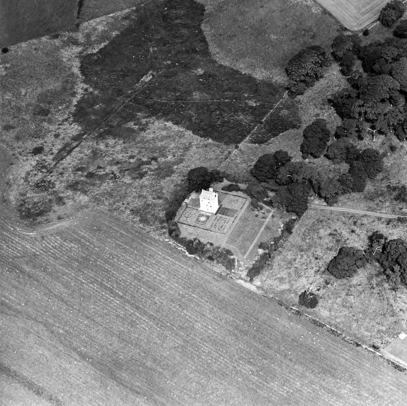 Oblique aerial view centred on the tower-house, taken from the S.