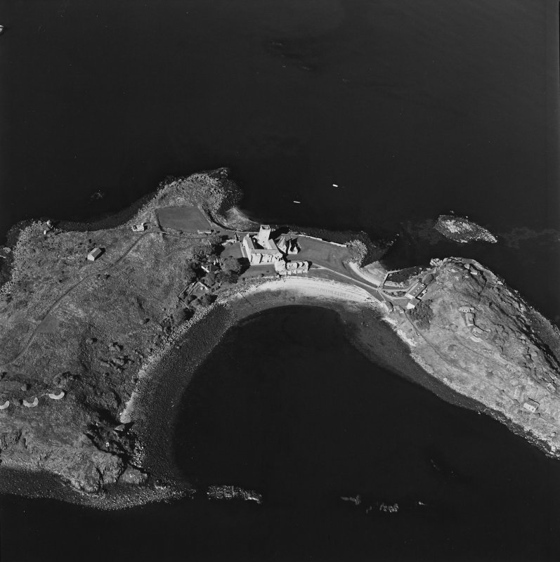 Oblique aerial view centred on the abbey with coast batteries adjacent , taken from the SSE.